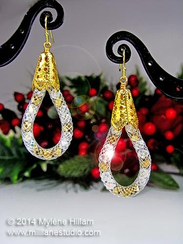 White plastic mesh tube earrings filled with crystal beads