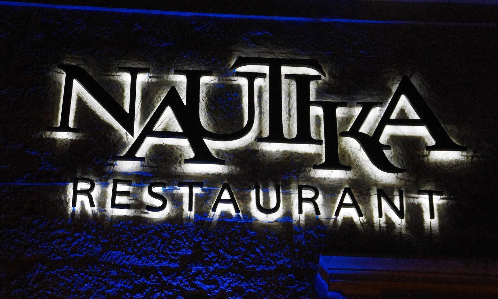 Nautika Restaurant Sign lit up at night
