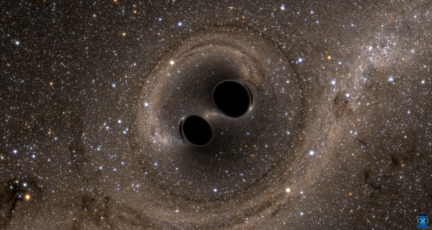 Artist's rendering of two black holes merging into one. Credit: SXS, the Simulating eXtreme Spacetimes (SXS) project (http://www.black-holes.org)