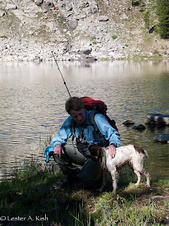 Hiker and dog at Golden Trout Lake, Montana
