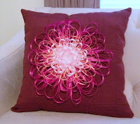 http://www.plumperfectandme.com/2016/03/ribbon-flower-embellished-napkin-pillow.html