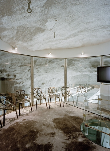 Photo of an underground office with glass table and chairs