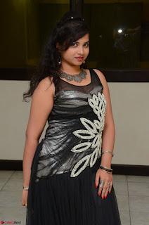 Shrisha Dasari in Sleeveless Short Black Dress At Follow Follow U Audio Launch 060.JPG