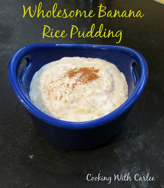 blue ramekin filled with creamy banana rice pudding and topped with a sprinkle of cinnamon