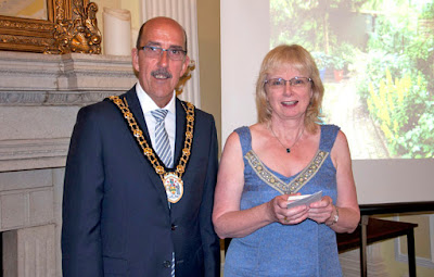 Councillor Jane Kitching, from Brigg, receiving her best garden award from the Mayor of North Lincolnshire, Councillor Trevor Foster. Picture courtesy of Christopher O'Rourke posted on Nigel Fisher's Brigg Blog, July 2016