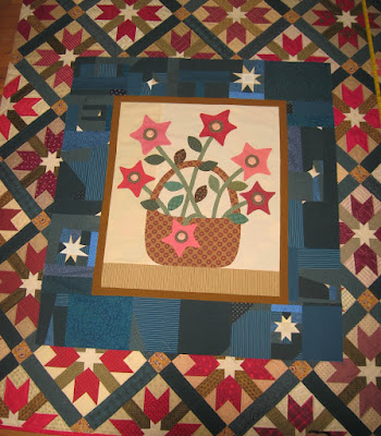 Gwennie Inspired medallion center on top of pieced blocks