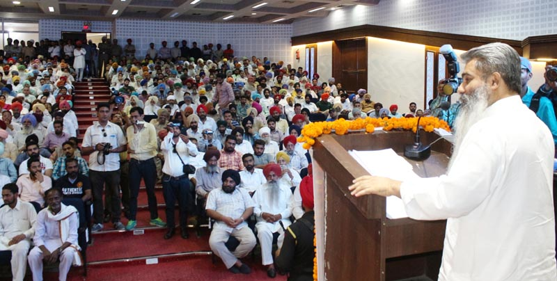 Cabinet Minister Bharat Bhushan Ashu addressing the gathering during a district-level debt-relief function in Ludhiana