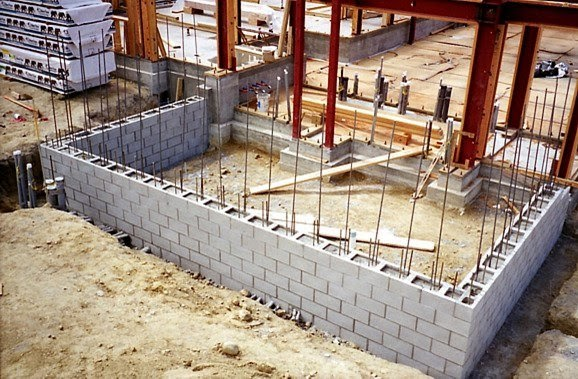Dry stacked interlocking masonry system mortarless for Concrete block foundation