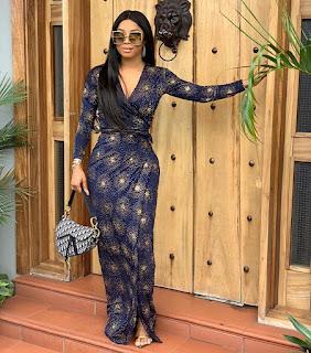 Toke Makinwa Looks Gorgeous As She Steps Out In Wrap Dress