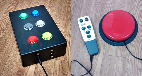 OneSwitch.org.uk adapted Sensory Room remote control with Sanwa buttons, and universal Doro learning remote with accessibility AbleNet switch.