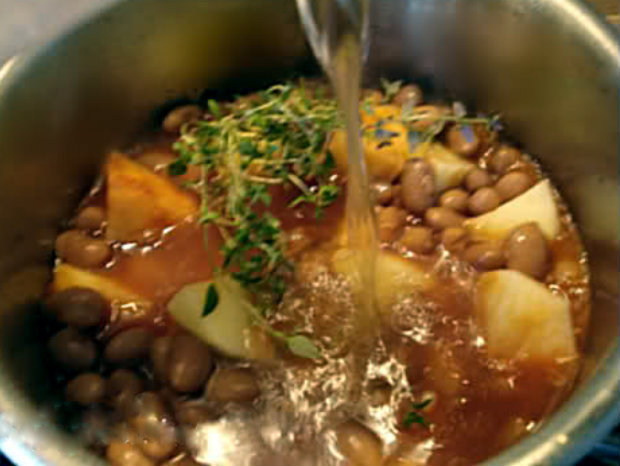 cooked beans, potato, tomato puree and thyme in water