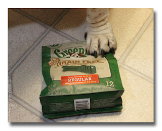 Paw on bag of Greenies