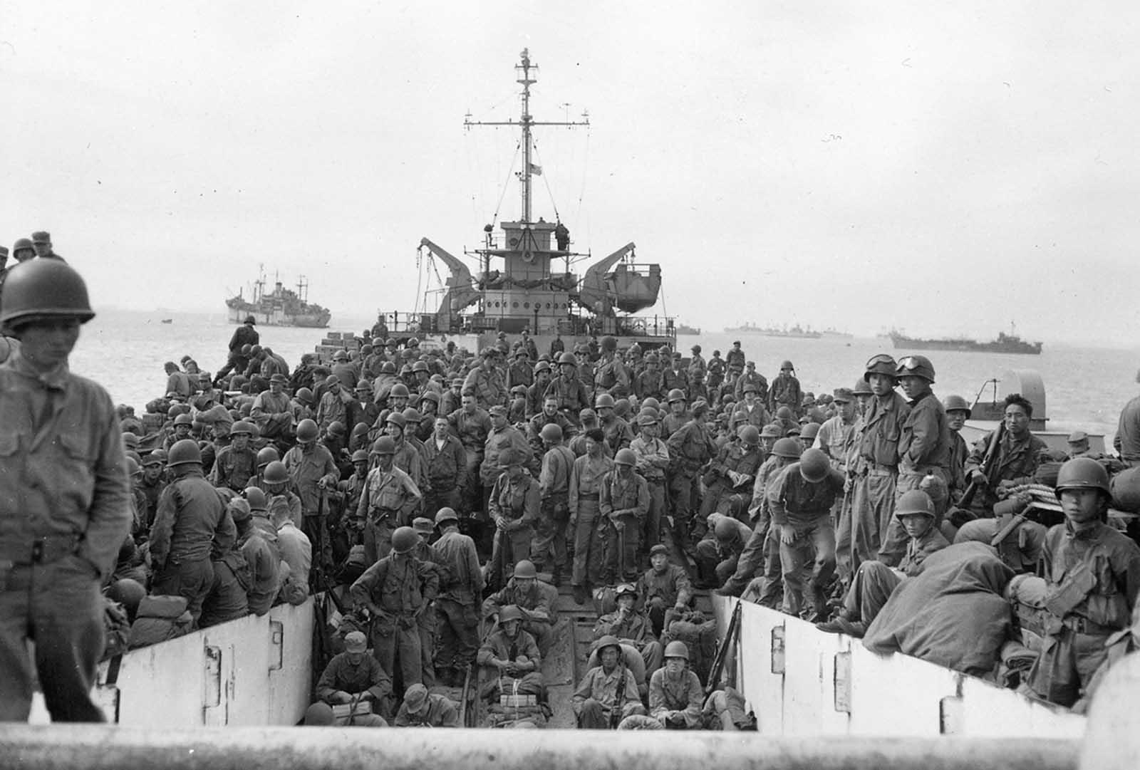 Troops of the 31st Infantry Regiment land at Inchon Harbor, Korea, aboard LSTs on September 18, 1950.