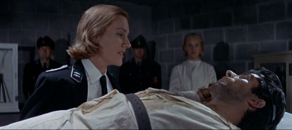 Anne Ridler tortures George Chakiris in 633 Squadron