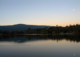 Moon reflected in Lake Vasona at sunrise.