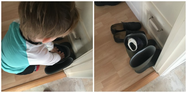 Our-Weekly-Journal-13th-March-2017-toddler-putting-jumper-into-wellington-boot