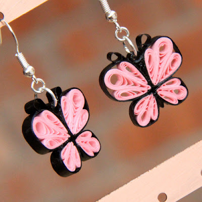 Earrings of butterflies made by paper quilling craft