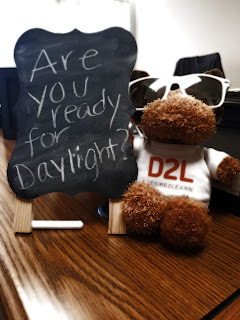 D2L moose thinks Daylight is so bright he needs shades and wrote a chalkboard message asking if Bloomsburg students are ready for Daylight