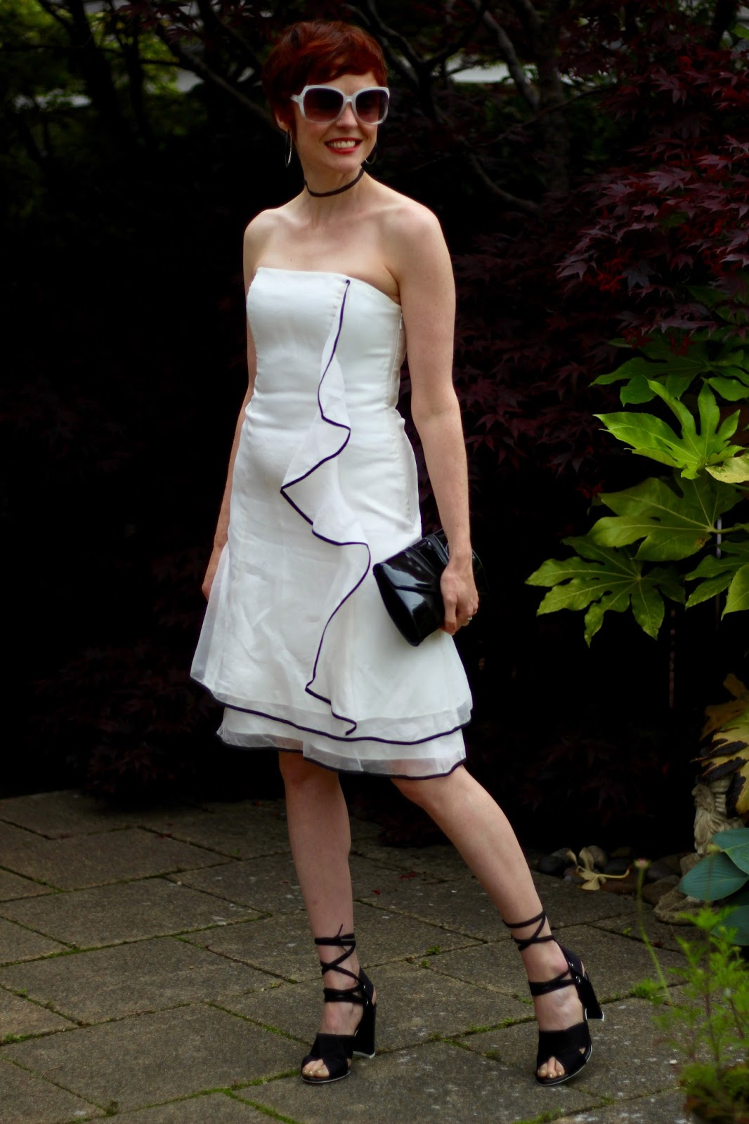 White ruffle strapless dress with black trim, topshop unique shoes, black vintage clutch.