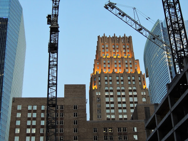 Iconic Gulf Building with Cranes on Skanska's Capitol Tower site in foreground