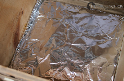 Wrap the warmed Nest Box Cozy in heavy duty aluminum foil  (protects it from becoming soiled) and place it on top of the insulation.