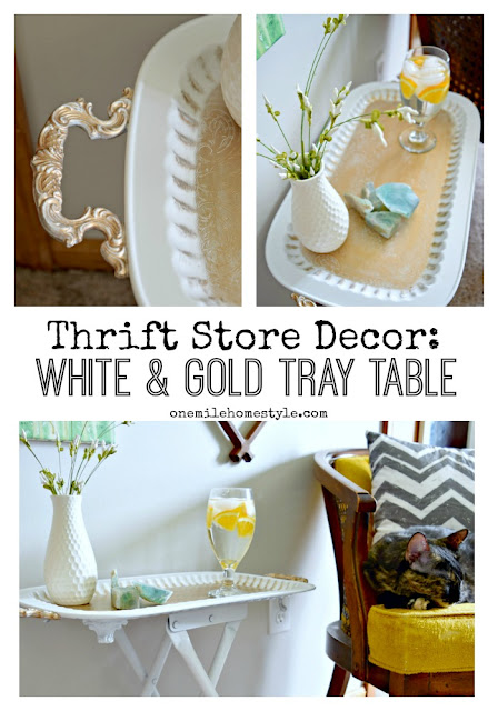 You won't believe what this beautiful accent table looked like before this blogger got ahold of it! DIY Thrift Store White and Gold Accent Table - One Mile Home Style