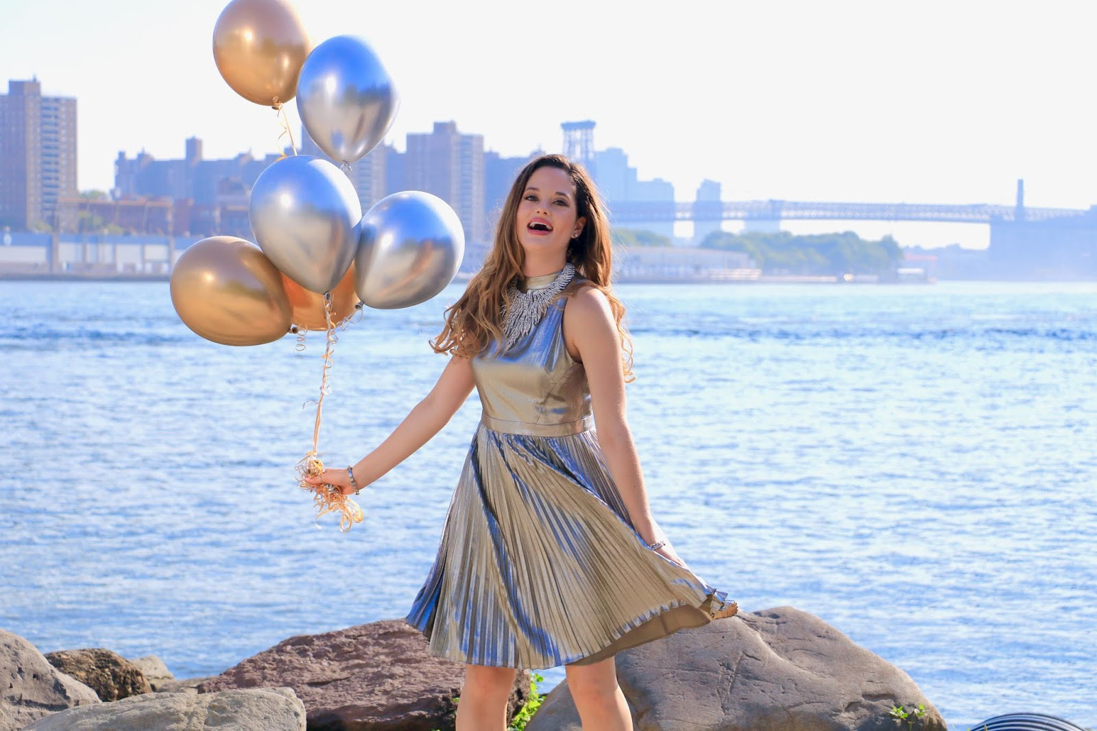 Nyc fashion blogger Kathleen Harper wearing a gold metallic dress