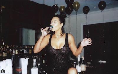 Kim K strips down to bikini and knocks back tequila shots