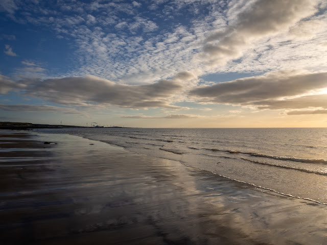 Photo of clouds reflected in the wet sand on Maryport beach