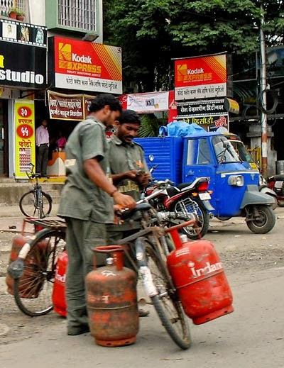 men delivering LPG gas cylinders