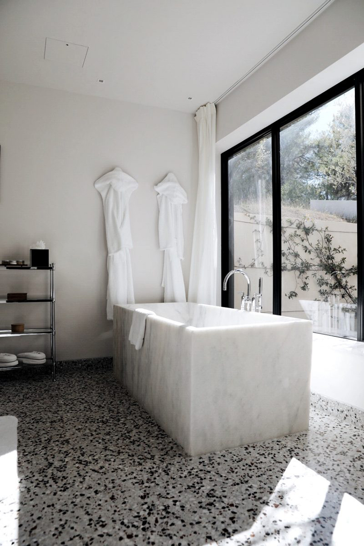 Contemporary marble bathtub via Damsel In Dior