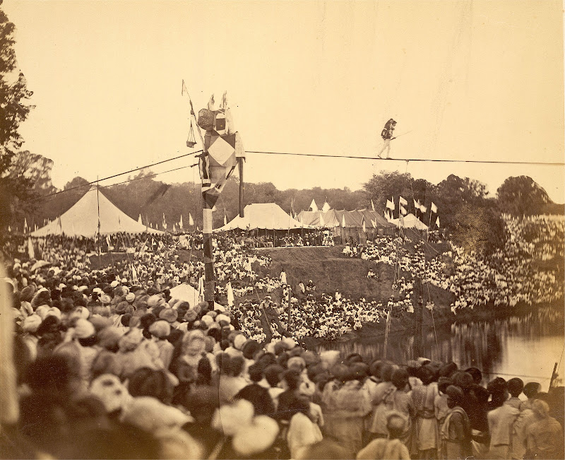 An European Tightrope Walker Crossing a Tank before a Large Crowd in Baroda (Vadodara), Gujarat - Circa 1880