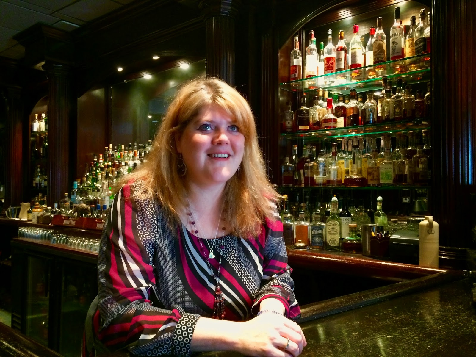 Brandi Lauck hanging out behind the bar while Arthur rambles on about whiskey