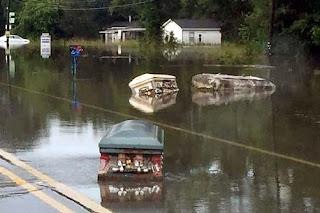 Floods dislodge coffins from graveyard