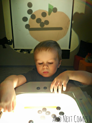 J making jack-o-lanterns on the overhead projector from And Next Comes L