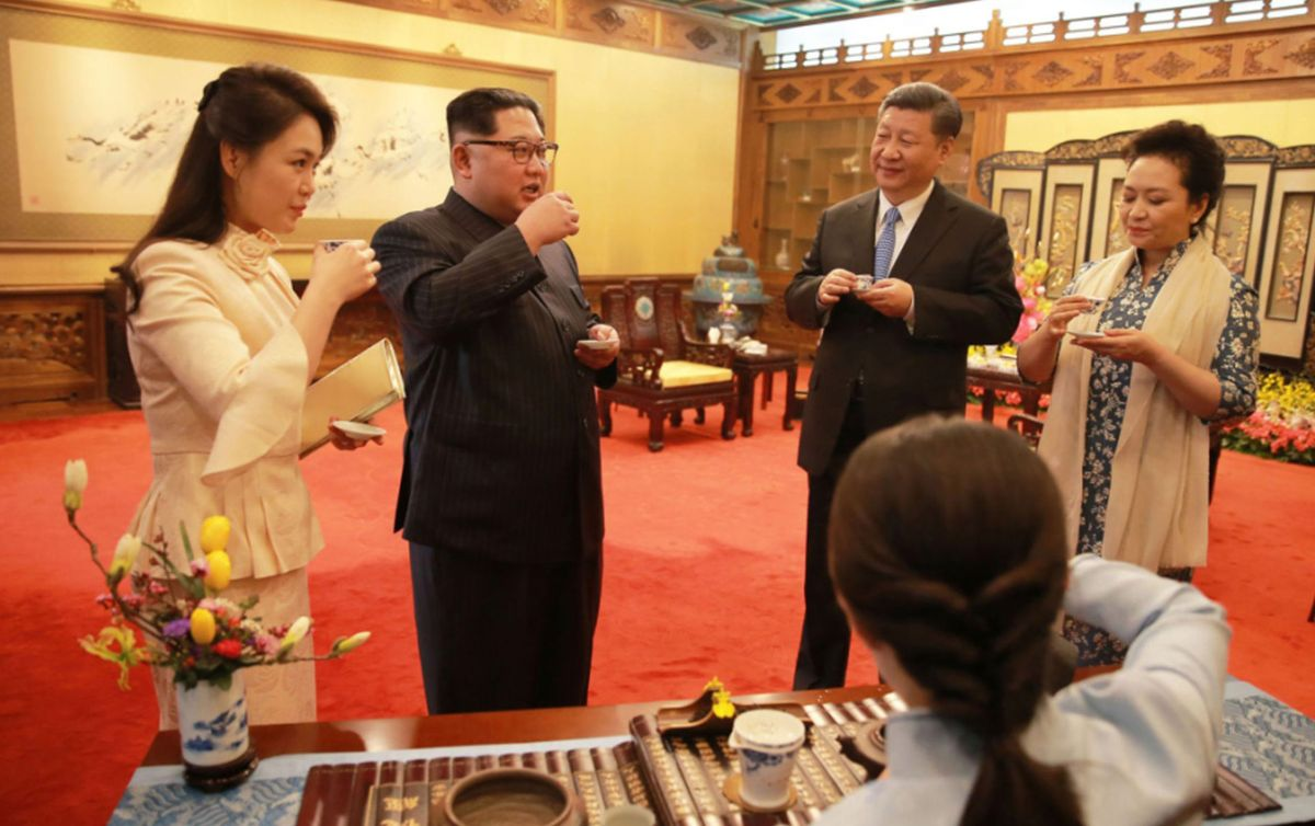 North Korean leader Kim Jong-un and his wife Ri Sol-ju meeting with Chinese President Xi Jinping and his wife Peng Liyuan as they visit the Diaoyutai State Guesthouse in Beijing.