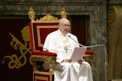 Pope in armchair