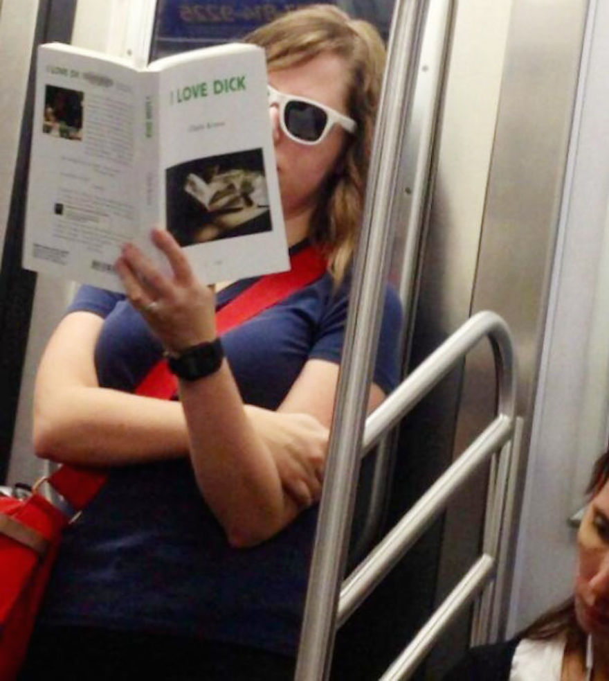 17 Hilarious Pictures Of People Reading All The Wrong Books In Public - This Girl's Reading Material Attracts A Lot Of Male Attention