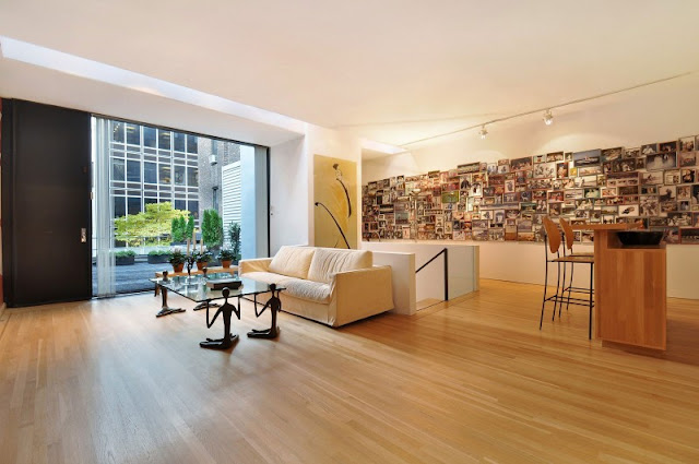 Photo of large upper floor living area with modern art sculptures and art on the walls