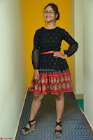 Aditi Myakal in Spicy Red Short Skirt and Transparent Black Top at at Big FM For Promotion of Movie Ami Tumi 081.JPG