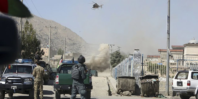 Image Attribute: An MD 530F military helicopter targets a house where attackers are hiding in Kabul, Afghanistan, Tuesday, Aug. 21, 2018. The Taliban fired rockets toward the presidential palace in Kabul Tuesday as President Ashraf Ghani was giving his holiday message for the Muslim celebrations of Eid al-Adha, said police official Jan Agha. / Source: AP Photo/Rahmat Gul