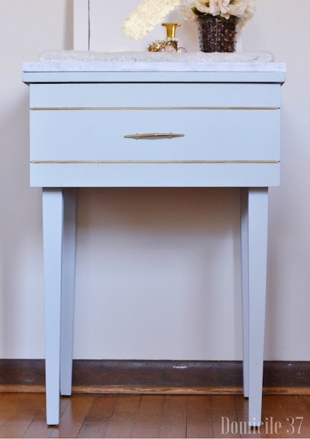 After image of vintage sewing machine turned vanity for the fab furniture flippin' contest using general finishes chalk paint in summertime blue