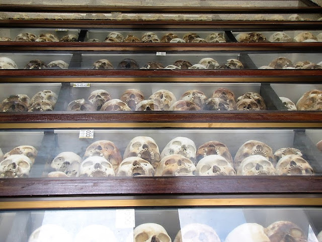memorial tower filled skulls killing field cambodia
