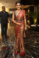 Tapsee Pannu Latest Stills in Red Silk Saree at Anando hma Pre Release Event .COM 0046.JPG