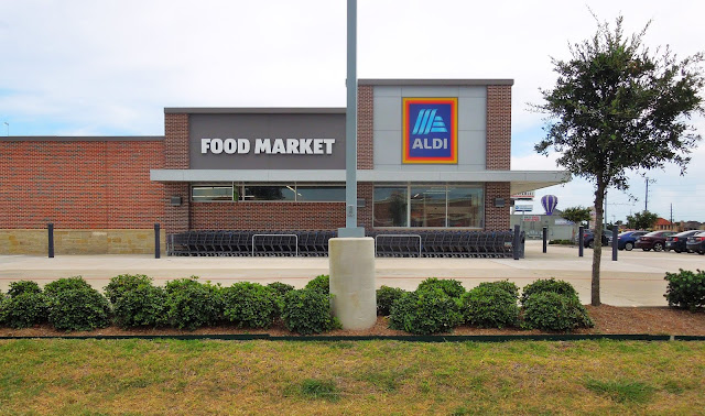 ALDI FOOD MARKET ON CORNER OF HIGHWAY 6 AND SCHILLER ROAD