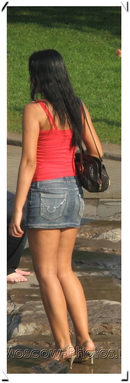 Sexy Moscow girl in denim mini skirt and red shirt