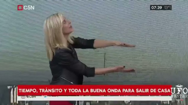This is where the news woman spots the UFO on Live TV.