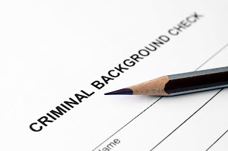 Criminal Background Check report with pencil