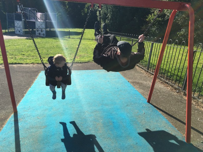 toddler-and-grandad-on-swings