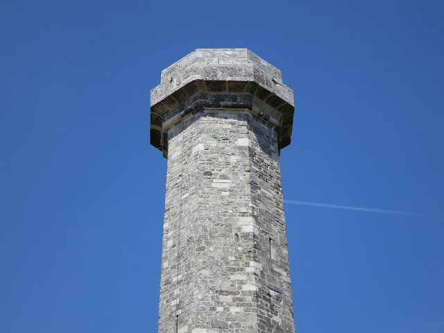 Hardy's Monument - stone pillar against blue sky.